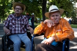 Carl Shepherd, left, and Cecil Bethea, right, smoke cigarettes while waiting for the start of the Pride parade on Sunday June 19, 2016 at downtown Denver, CO. Shepherd and Bethea are both Air Force veterans marching with American Veterans for Equal Rights. Photo by Carl Glenn Payne
